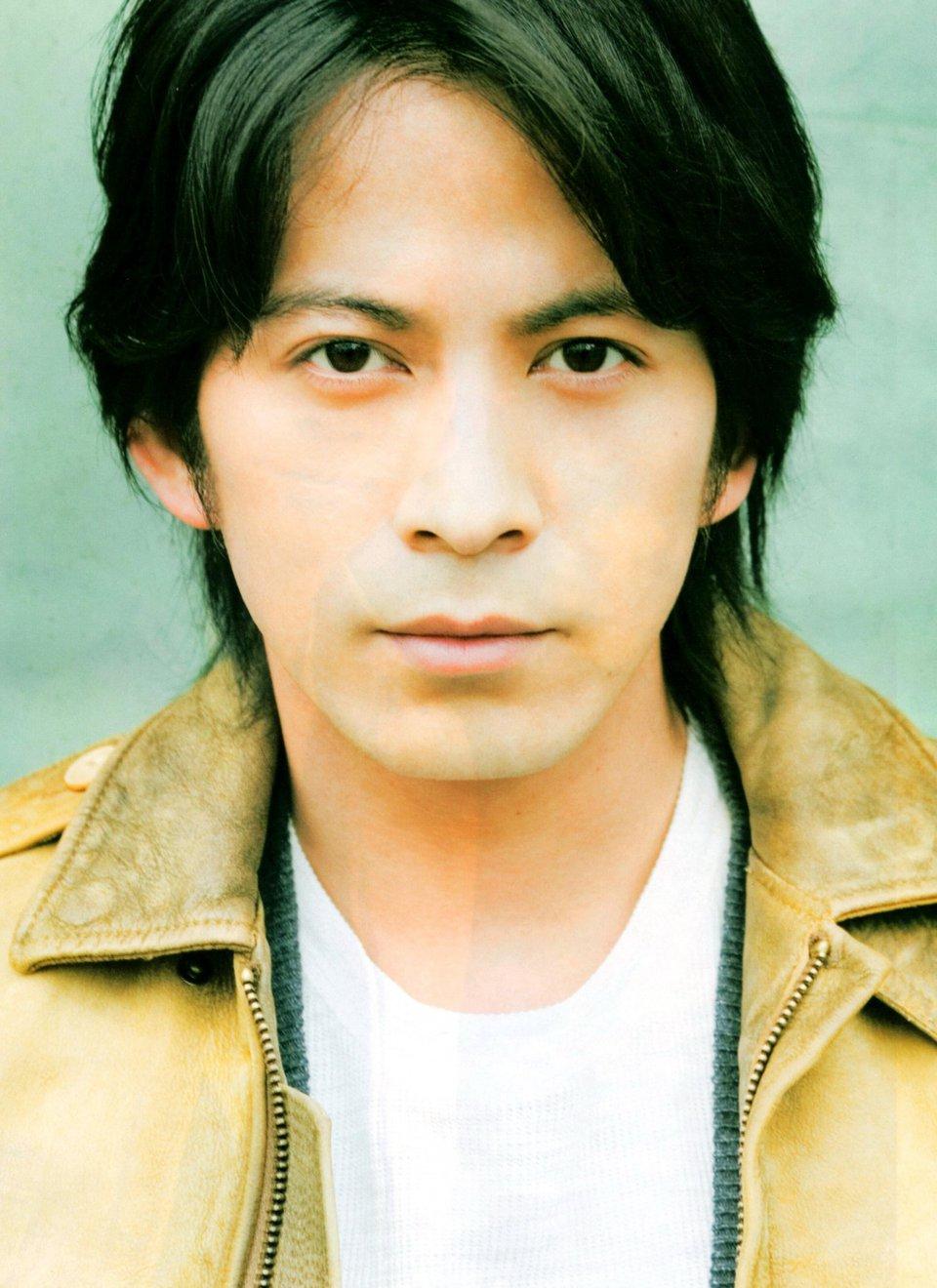 фото Джуничи Окада